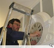 The clock being replaced in the entrance screen