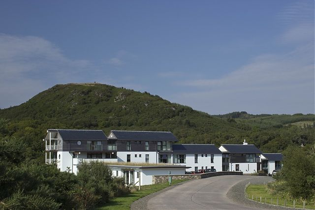 View of Staff Accommodation and Hotel from south with single storey Studio Apartments in foreground.