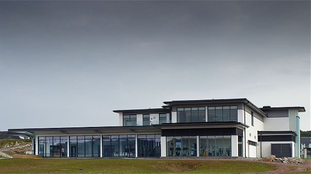 View from Loch Fyne breakwater. Poolhall and gym on ground floor and spa and external terrace on upper.