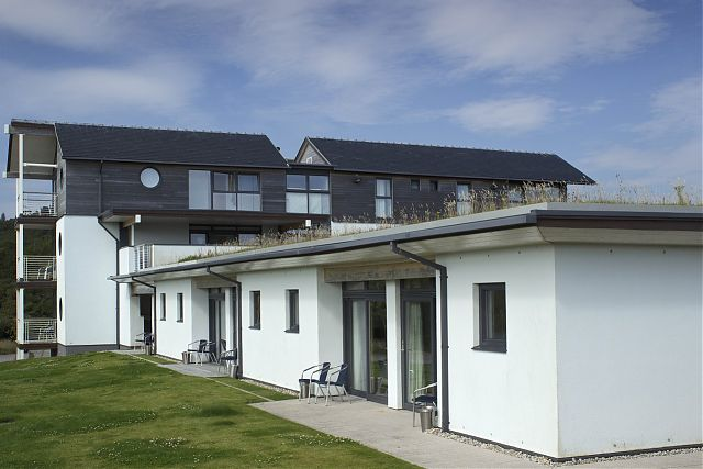 View of Studio apartments with staff accommodation in background.